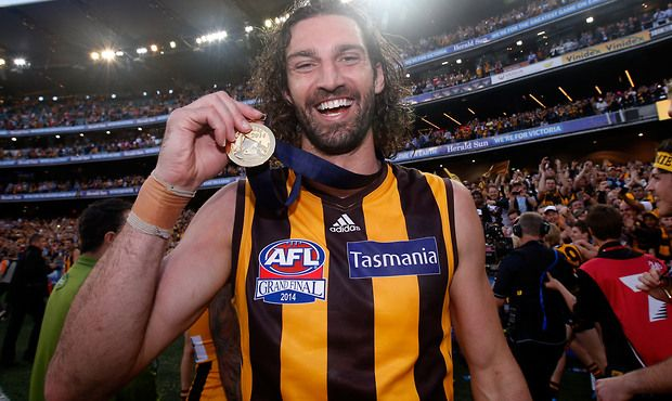 Matt Spangher of the Hawks celebrates after the 2014 Toyota AFL Grand Final match between the Sydney Swans and the Hawthorn Hawks at the MCG, Melbourne on September 27, 2014. (Photo: Darrian Traynor/AFL Media)