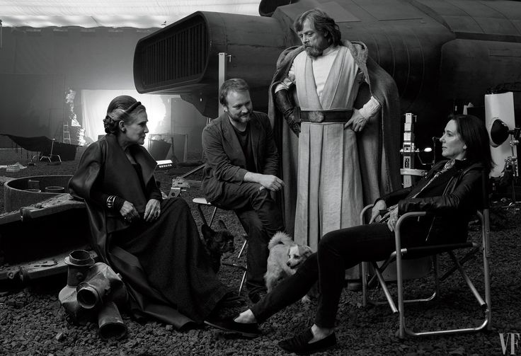 Off Duty Carrie Fisher (General Leia Organa), writer-director Rian Johnson, Mark Hamill (Luke Skywalker), and producer Kathleen Kennedy with Fisher's dog, Gary, and Hamill's daughter's dog, Millie.