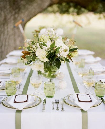 Adding strips of ribbon to plain white table setting creates a stylish look - Green and brown wedding details  Would work in any colour or mixed pastels!!
