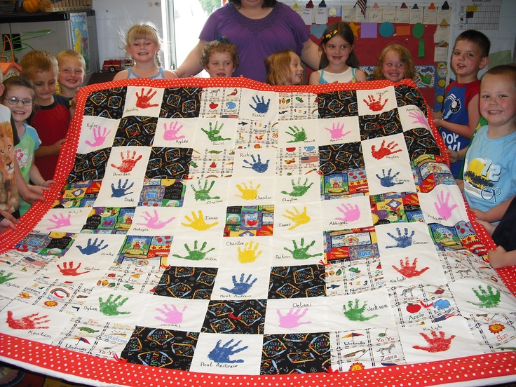 2010 Mrs. Kaiser's Pre-K class quilt.  We got all the students to paint their hands on 1 block each and stamp them on blocks.  9- 9 blocks with school fabric in between.  Border= red, tied white=)
