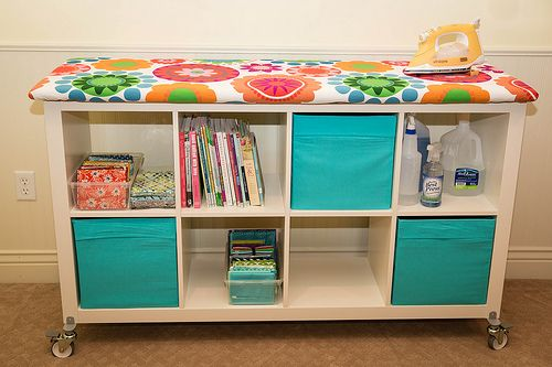 "My version of of a Big Board Iron station. Ikea Expedit Bookcase, installed Expedit Casters, cut plywood 60"" x 22"", secured 4 layers batting with staple gun, followed this tutorial for cover http://www.minneapolismqg.com/2013/07/saturday-series-quilting-away-from-home.html"
