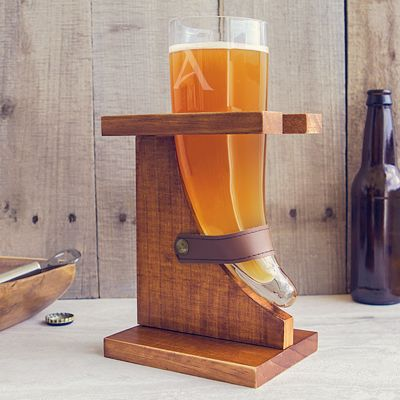 Viking horn full of beer next to a beer bottle