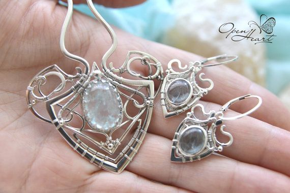 Jewelry set, silver earring and hair pin with natural light blue aquamarine. Elegant and delicate unusual jewelry made in the technique wire wrap. Subtle delicate fine silver ornament emphasizes the tenderness of stones.  Dimensions decorative parts: 5 х 5,5 cm or 2 x 2,2 inches  The length of the tooth comb: 10 cm or 3,9 inches  Dimensions of earrings: 4 x 2 cm or 1.6 x 0.8 inches  Materials: silver 925, aquamarine.  MADE TO ORDER! will be ready within 4-6 weeks after the order has taken…
