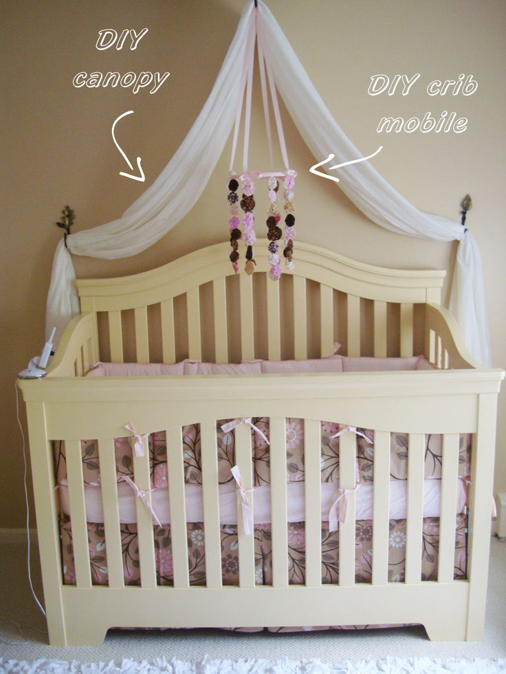 Leahs nursery diy canopy 2 white curtains from target for Drapes over crib