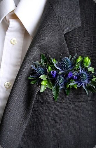 Floral pocket square instead of a bout.. unique!
