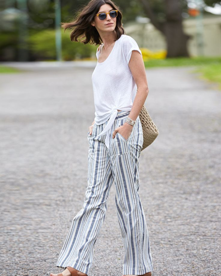 Sunday Stylist Tip: Pair a bright white tee with wide-leg linen pants for a breezy weekend look. #StylistTip