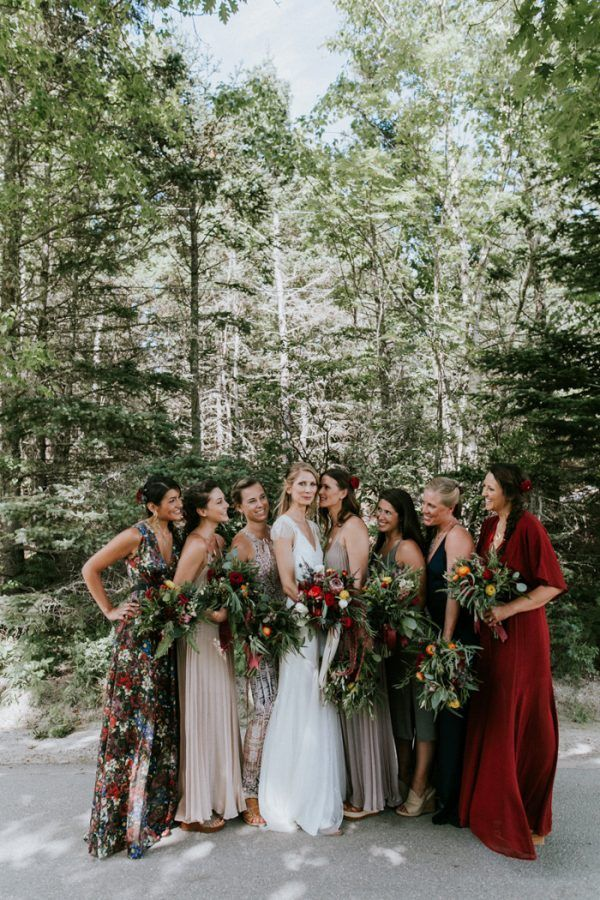 Boho Maine wedding | Red mismatched bridesmaids with flower crowns