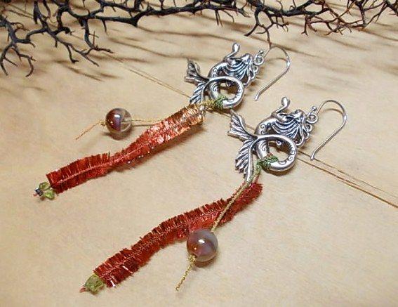 Summer earrings with metal mermaids, multi coloured yarn & glass beads...<3