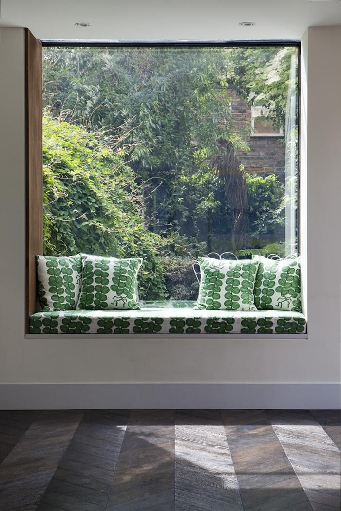 Window seat w/leaf print textiles extends the garden, London Fields neighborhood, London, expanded Victorian