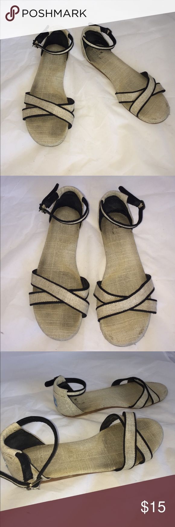 Canvas Tan & Black TOMS open Toe sandals 7.5W These are used TOMS sandals. Just dirty needs a wash or spray/soak in Oxy clean. Very comfortable sandals. Perfect for Now. Women's Size 7.5 Toms Shoes Sandals