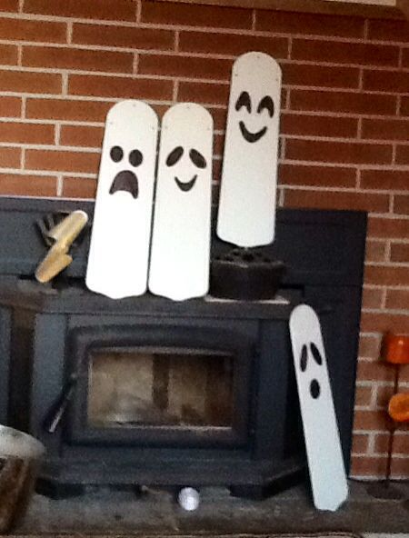 Boo!  Ghosts from ceiling fan blades and a Sharpie. I hung these with fishing line on trees and they spin in the wind.