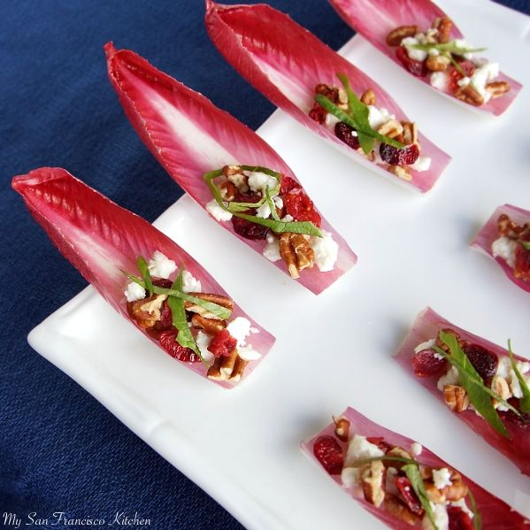 Red Endive with Dried Cranberries, Pecans, Feta and Arugula - Drizzle with a champagne or red wine vinaigrette if desired.