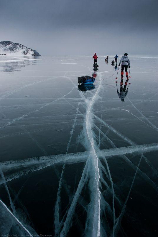 Skating on iced Baikal lake (Siberia)