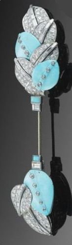 AN ART DECO DIAMOND AND TURQUOISE SÛRETÉ PIN, CARTIER, CIRCA 1925. Of foliate design composed of brilliant-cut and baguette diamond leaves interspersed with carved turquoise leaves and accented with lines of single-cut diamond collets, to a similarly set guard, signed Cartier and numbered indistinctly.