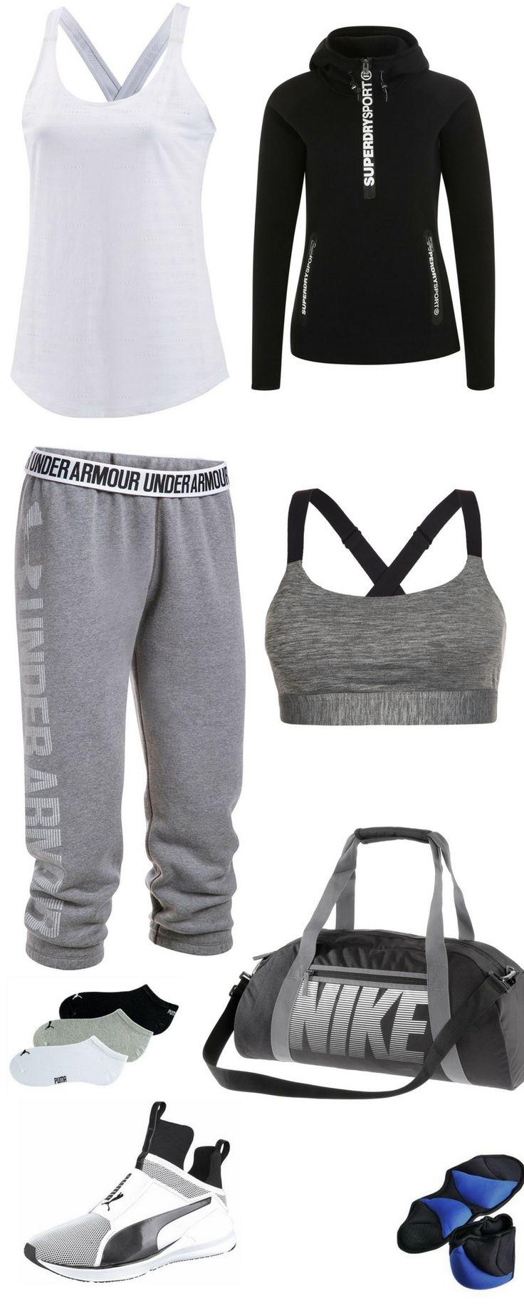 """Fitness Outfit für Frauen: """"It's all about being good to yourself"""" - Weißes Tanktop, schwarzer Hoodie von Superdry, graue Jogginghose von Under Armour, grauer Sport-BH, Sporttasche, Gewichtsmanschetten und Sport-Füßlinge"""