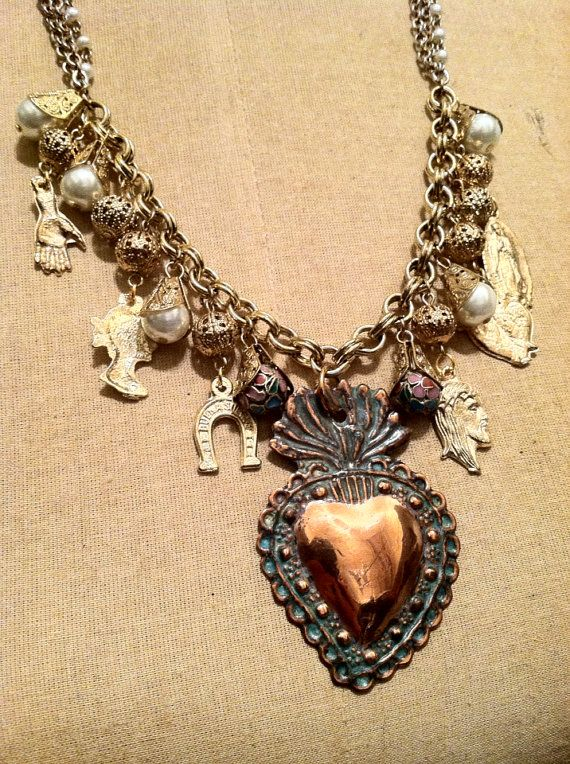 Pictured here is a gorgeous and one of a kind handmade Religious Sacred Heart Milagros Charm necklace. The triple linked chain measures 22 in length