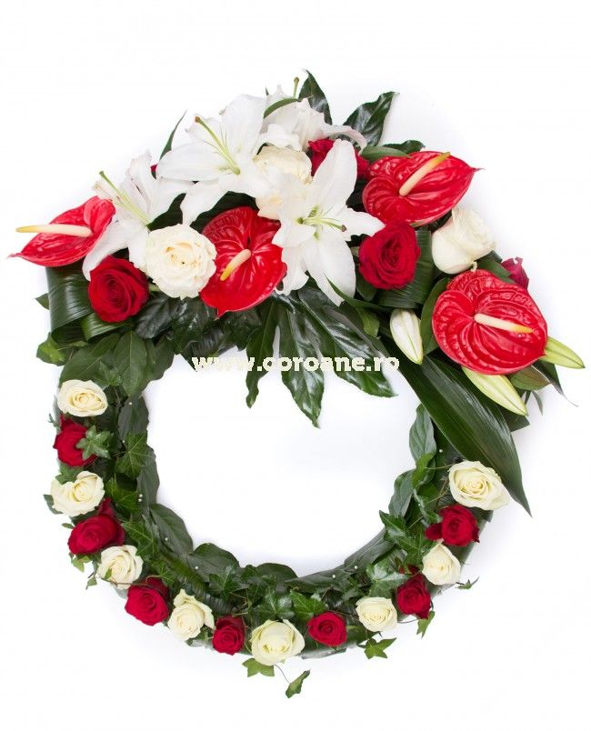 Coroana funerara eleganta, din trandafiri rosii si albi si anthurium rosu. Aceasta este decorata cu frunze de iedera si crini, pentru un plus de eleganta!