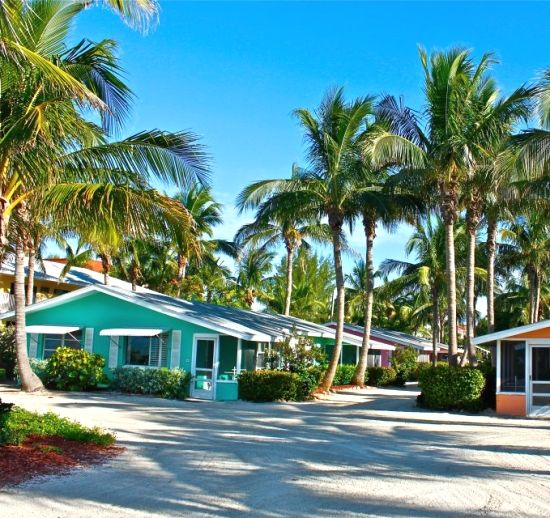 Beach Cottages in Sanibel... Turquoise, Pink, Orange, Green... and named after fruit. Featured on BBL: http://beachblissliving.com/waterside-cottages-on-sanibel-island-florida/