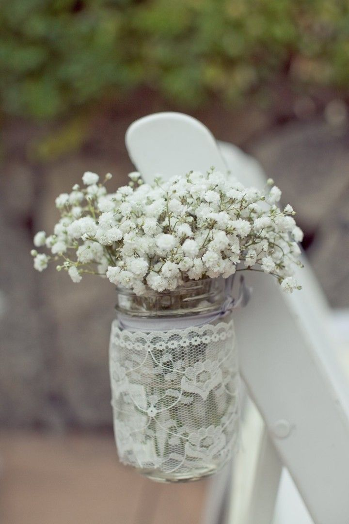 wedding ceremony flower idea; photo: Carlie Statsky