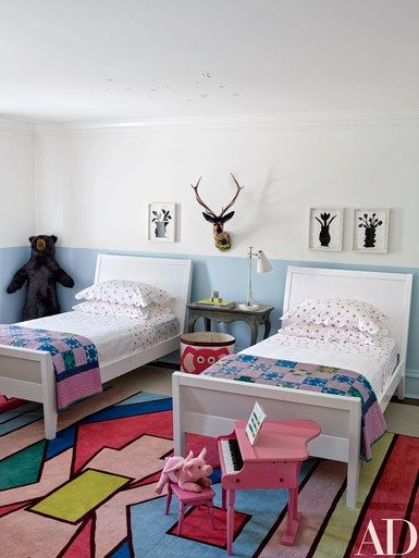 Edie's room features Donald Baechler stenciled flowers, beds from the Land of Nod, and bedding by D. Porthault   archdigest.com