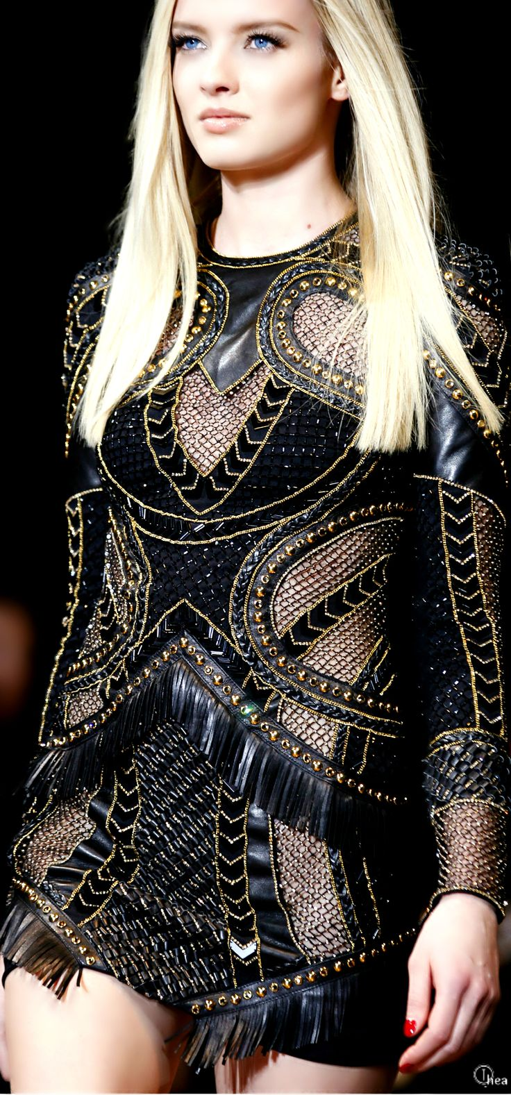 Versace Fall 2014. I really do like this rock-chick, biker styled edgy creation. I love the use of leather along with plain black materials, the mesh cut-outs are a must have, the golden styled thread throughout is exactly on point, and the small patches of tassels are super fun and cute. I really like this one.