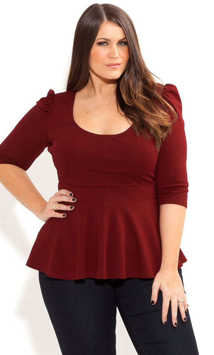 Peplum shirt in sizes 12, 14/16, 18/20, 22/24, 26/28, 30/32 Fit and Fashion Notes: The fit and flare style of this peplum top creates a feminine silhouette that's sophisticated and chic.