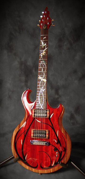 "$12,000 VIRGIL Guitars Silver Willow custom electric. RESEARCH from maker #DdO:) - https://www.pinterest.com/DianaDeeOsborne/instruments-for-joy/ - Virgil's first carved top. Used new ""SW Series"" shape to improve previous design #Dueling #Dragons: Gives easier access to upper frets with better cutaway with the lower horn. Added cocobolo body, zebrawood center layer & a padauk top. Pigtail Wraparound bridge. This 3/5/2012 guitar Serial 0002 was never chambered, so the weight was considerable."