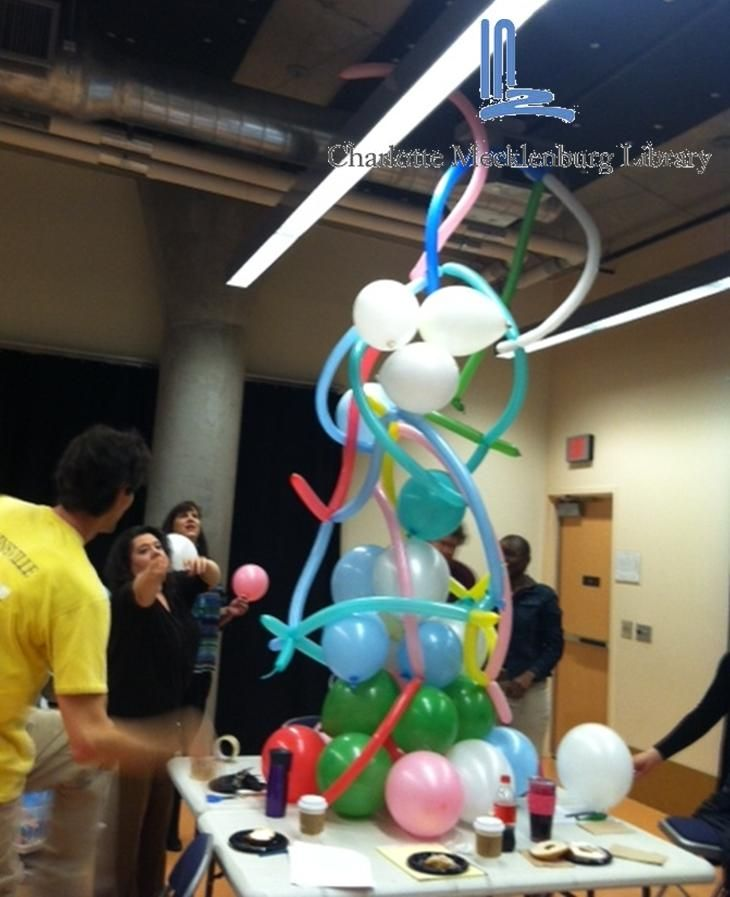 Building the tallest balloon sculpture. Ice breaker activity before all staff quarterly meeting. This is how we roll at ImaginOn! ^kc