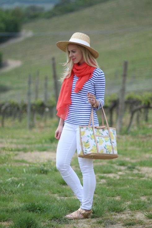 Summery Panama hat, royal blue striped boatneck tee with a coral scarf, white jeans, and sandals.