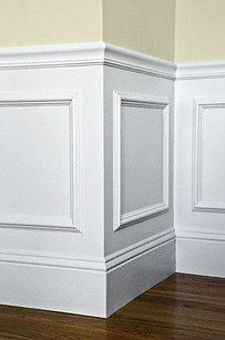 Use picture frames as wainscoting. | 40 Easy DIYs That Will Instantly Upgrade Your Home