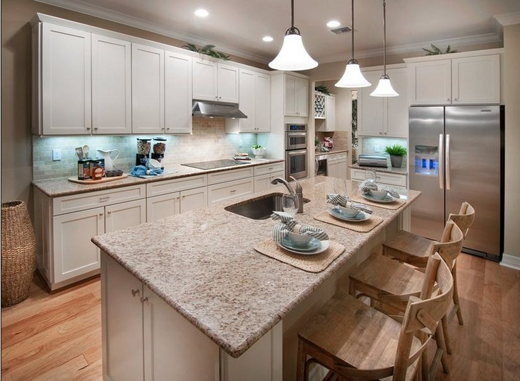 Pulte Homes See More Warm Tones And Clean Lines Make This Copperleaf Community Kitchen Design Both Modern Welcoming