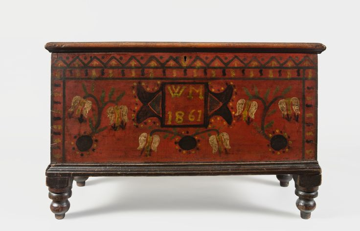 """The Rick & Terry Ciccotelli Folk Art Collection - Small Paint-Decorated Lift-Top Chest Inscribed """"W.M."""" Western Pennsylvania, Dated 1861 - Pine, original painted decoration, 22 1/4 x 34 x 16 inches. Inscribed on the front """"W.M."""" / 1861"""""""