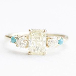 An amazing engagement ring featuring a radiant cut yellow diamond with antique diamonds and natural turquoise cabochons   Mociun Custom