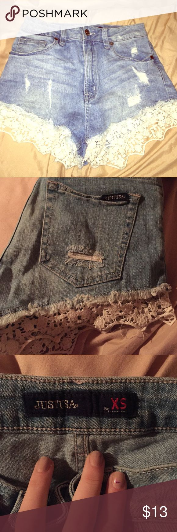 Distressed lace denim short Adorable high waisted, distressed style light wash denim shorts with lace trim at the bottoms! gently worn, size extra small, brand is Just USA and was purchased at a boutique on LI JUST USA Shorts Jean Shorts