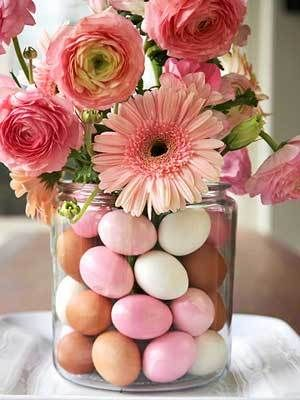 Easter-themed centerpiece adorned with pastel Easter eggs, roses and daises. Pinned for BabyBump, the #1 mobile pregnancy tracker with the built-in community for support and sharing.