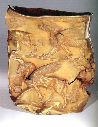 Golden Cup depicting Griffin on top band. Excavated at Marlik, Gilan province of Iran. First half of first millennium BCE. Marlik is an ancient site near Roudbar in Gilan, north of Iran, the site of a royal cemetery.