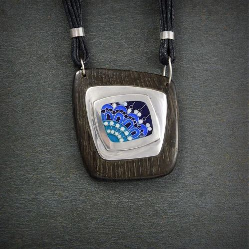 """Silver pendant framed into bog oak wood and decorated with ornament made of Georgian's enamel- unique technique """"Minankari"""" known as Cloisonne."""