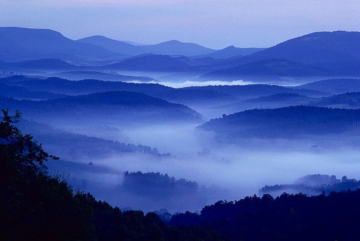 """The North Carolina mountains inspired the setting for the Nicholas Sparks novel """"The Lucky One."""" The region features lush green landscapes, cool mountain streams, the highest peak in the East and the Blue Ridge Parkway, known as America's Favorite Drive."""