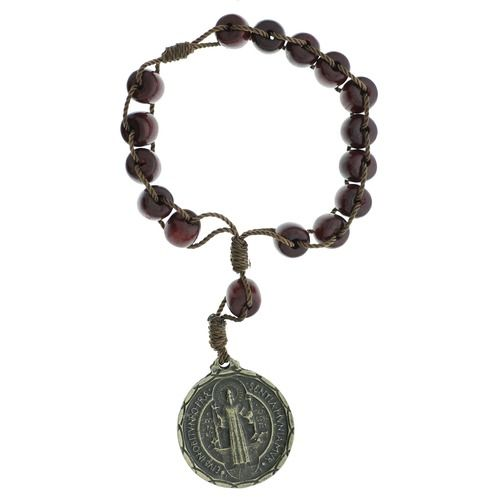 This uniquely designed Brazilian wood St. Benedict decade rosary is a great way to meditate on the mysteries with a smaller, compact rosary. Simply use the five beads (decade beads) as way to keep focused on each mystery and move the ten beads (Hail Mary beads) to keep track of each prayer. Perfectly sized for slipping into a pocket or purse.