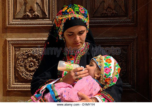A young woman with her baby girl both dressed traditionally at Olympos village, Karpathos, Dodecanese islands, Greece. - Stock Image