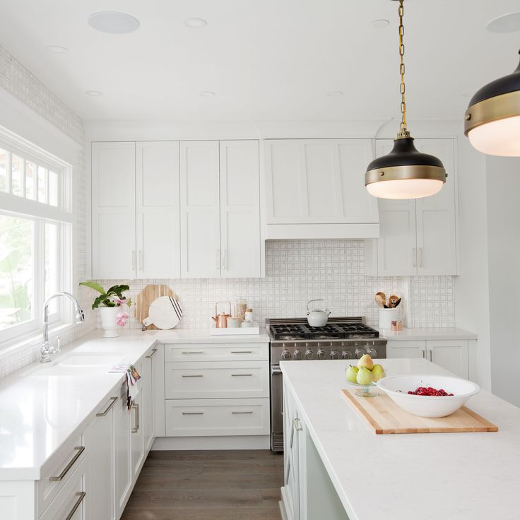 Love It Or List It Vancouver: Christine & Chris. Crisp white kitchen.