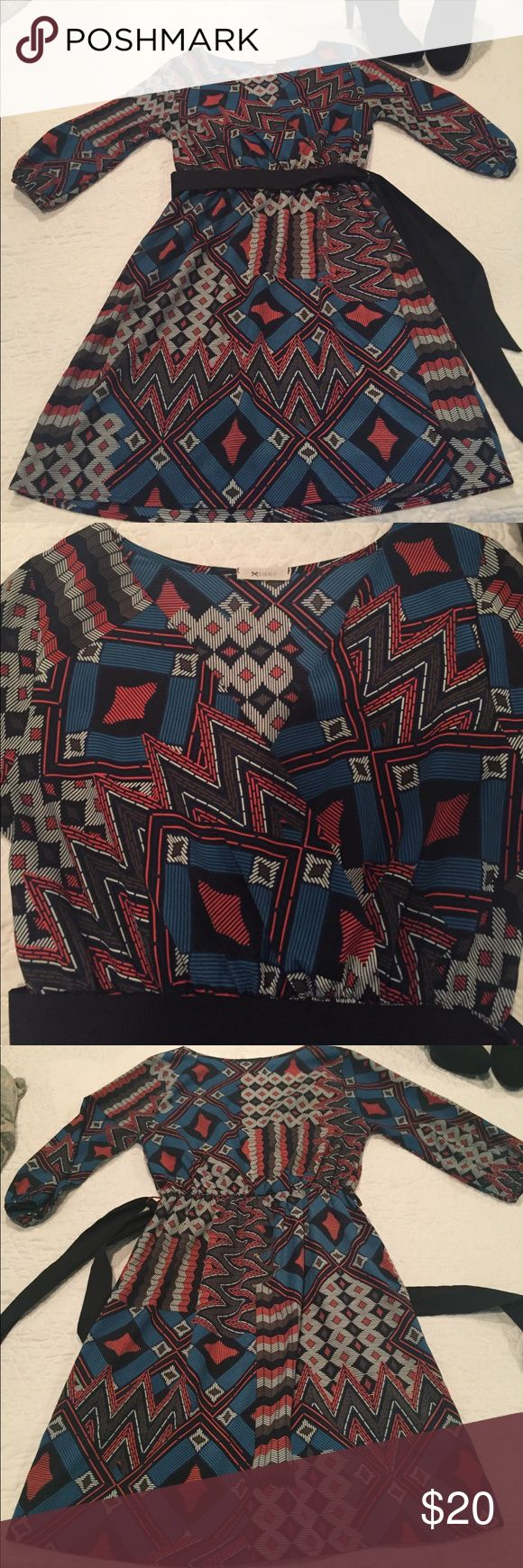 Beautiful everly dress 3/4 length sleeves sheer everly dress. Size medium worn once . Would fit a size 6, 8, or 10 . Stretch in the waistband. Blue, coral , and black colors in the print with a black sash to tie around waist . Everly Dresses