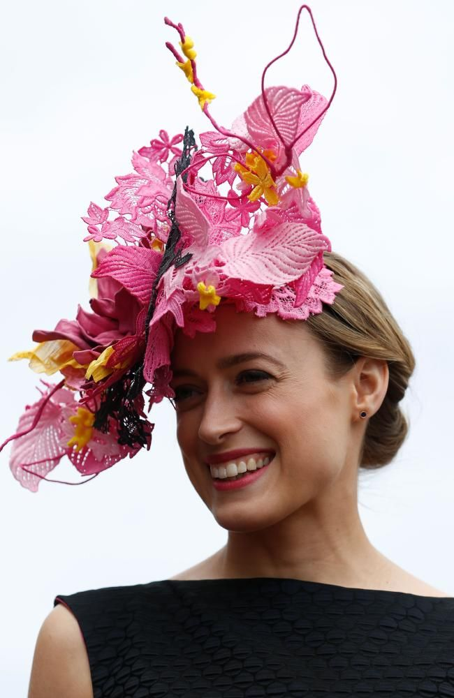 Emily Hunter beams after being crowned the winner of Myer Fashions on the Field Women's Racewear winner. Picture: Zak Kaczmarek/Getty Images.