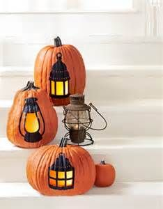I like the lantern idea if the actual pumpkin was also painted silver or gold or white...
