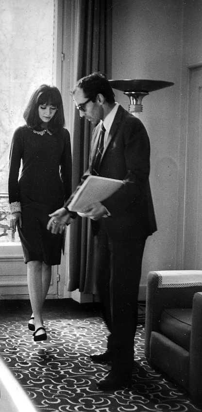 Karina and Godard. On the set of Alphaville I'm assuming. http://www.youtube.com/watch?v=e7m3iO0blDc&feature=related