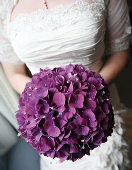 wedding bouquet of purple hydrangea with sprays of clear crystal