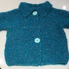 Manteau tricoté  bleu vert avec des reflets roses brillants