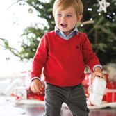 A warm red sweater and collared shirt over cords makes the perfect outfit for pictures with Santa. Don't forget the festive socks and dress shoes!