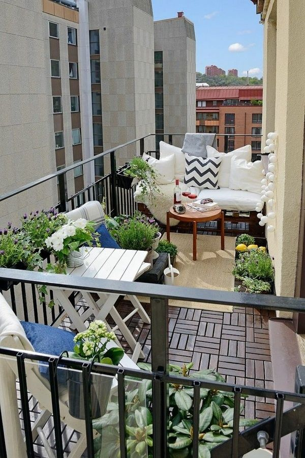 Balcony design ideas Wooden tiles plants balcony furniture