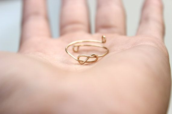 Hey, I found this really awesome Etsy listing at https://www.etsy.com/listing/109648116/gold-infinity-knot-ring